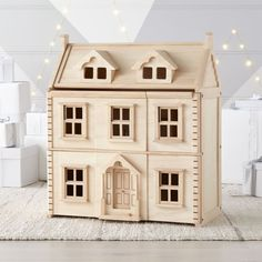 Let their imagination run wild with kids' wooden toys. From play food sets and train tracks to clutching toys and teethers, find all the toys your little ones will love. Play Kitchen Sets, Toy Kitchen, Dollhouse Toys, Wooden Dollhouse, Dollhouse Design, Dollhouse Ideas, Furniture Plans, Custom Furniture, Kids Furniture