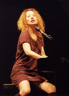 "Tori Amos (born Myra Ellen Amos; August 22, 1963) is an American pianist, singer-songwriter and composer. She was at the forefront of a number of female singer-songwriters in the early 1990s and was noteworthy early in her career as one of the few alternative rock performers to use a piano as her primary instrument. Some of her charting singles include ""Crucify"", ""Silent All These Years"", ""God"", ""Cornflake Girl"", ""Caught a Lite Sneeze"", ""Professional Widow"", ""Spark"", ""1000 Oceans"", and ""A…"