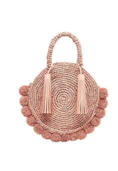 b1a318dee0a7 Round straw tote in ballet raffia with raffia pom poms. Take with you on  your