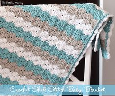 This shell stitch baby blanket made with Lion Brand Cotton-Ease is a great bedcover for summer.Pattern by The Stitchin' Mommy.