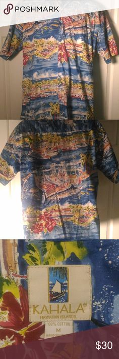 Kahala Hawaiian Tropical Shirt in Men's Medium Avi Kiarti is an artist from Maui's North Shore.  He has designed the graphics for Kahala Hawaiian Islands Aloha Shirts and has created classic designs that are coveted in Hawaii. This soft shirt features a fish market scene with large Blue Fin Fish, Palm Trees and the Ocean Blue. The stores have little names on them, lots of great detail please review all pics to appreciate the design on the front and back!  Size: M Actual Measurements: Across…