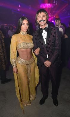 Sonny and Cher! Kim Kardashian and her best friend, Jonathan Cheban, transformed into the famous duo for the Casamigo's annual bash.