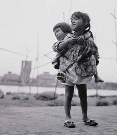 """Shomei Tomatsu. """"Sisters, Tsukudajima, Tokyo,"""" 1955"""
