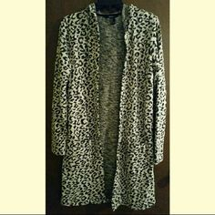 Sweater From forever 21. Very cute cheetah print. Soft and so comfortable. Great condition! Perfect for fall/ winter! Cream/ white and black. LONG. Says size small. Would fit medium too. Forever 21 Sweaters Cardigans