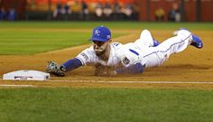 Eric Hosmer of the Kansas City Royals dives to force out Nelson Cruz of the Baltimore Orioles at first base during the second inning of Game 3 in their playoff matchup on Oct. 14 in Kansas City, 2014 MLB playoffs