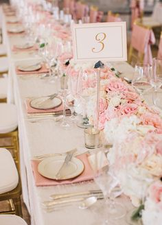 Pink floral runner and simple elegant table number. #weddingcenterpiece