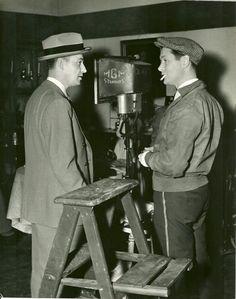 "Robert Montgomery on the set of ""Night Must Fall""."