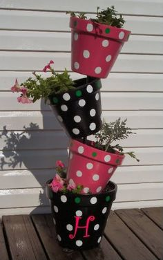 Tipsy Pots  I really would like to make 2 oe 3 of these for my back yard...Maybe in really BOLD colors? Yellow, Orange, and Red?