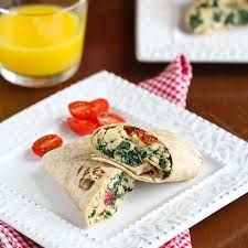 Scrambled Egg Wrap Recipe with Spinach, Tomato & Feta Cheese. 3 large eggs cup cherry or grape tomatoes 2 cups fresh spinach leaves 1 tbsp crumbled feta cheese 2 basil leaves 2 whole wheat tortillas Breakfast Wraps, Breakfast Options, Breakfast Dishes, Breakfast Time, Breakfast Recipes, Breakfast Spinach, Breakfast Specials, Vegetarian Breakfast, Free Breakfast