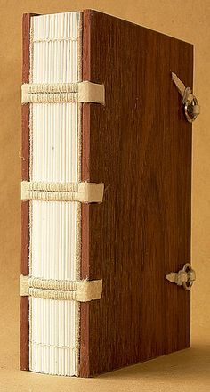 medieval binding / spine detail. work by ortbindery, .a blank book, with gauffering on the edges of the book block, jarrah boards, and sewn on pale cream buffalo straps... medieval style... via Flickr