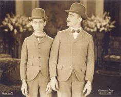 Bowler hats, slightly short at the sleeves, bowties, soft lines. Shaw  Lee: Vaudeville duo