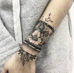 Floral cuff tattoo by Vlada Shevchenko