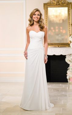 Low's AR Essence Style 6052 Wedding Dress by Stella York. From the Stella York wedding dress collection, sweetheart neckline gown made with Chiffon sheath and featuring figure-flattering criss-cross ruching on the bodice.