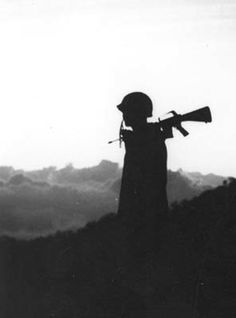 Soldier Silhouetted at Sunset is listed (or ranked) 5 on the list Cool Old School Pictures from Vietnam