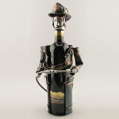 This fireman does not extinguish fire but instead satisfies your appetite for wine! (Delivery excludes wine bottle)