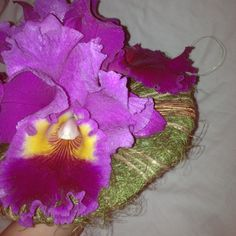 Bridal bouquet of cattleya orchids in holder