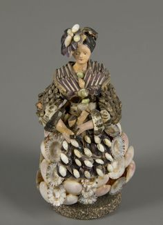 """Shell Doll doll 1860 In the 1840s, women's magazines offered instructions in shell handicrafts and sold quantities of shells in uniform colors and sizes. As the hobby gained popularity, even the Sears, Roebuck & Company catalogue offered shells in boxes of 100 pieces priced at one dollar for """"Panama Shells,"""" and 34 cents for """"Money Cowrie Shells."""" Germany or France"""