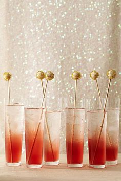 Holiday Cocktails with Gold Swizzle Sticks #sparkle #red #camillestyles