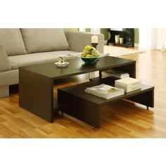 """2-in-1 Coffee Table by Brookstone. $164.99. 2-in-1 Coffee Table. Unique table features a 2-in-1 table design with a smaller table that can be extended to offer more table space. Chic coffee table features a smaller table that you can glide out when more table space is needed. Smaller table is equipped with wheels for easy mobility. Coffee tables feature a solid construction with MDF and strength enhancing wood veneer. Dimensions: Large Table: 47""""L x 24""""W x 17""""H Small Table: ..."""