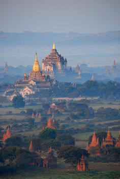 ミャンマー Bagan Temples in the morning mist, Myanmar. I am visiting this country in 3 weeks time, wonder if i can get to see sure a scenic place. Places Around The World, Oh The Places You'll Go, Travel Around The World, Places To Travel, Travel Destinations, Places To Visit, Around The Worlds, Bagan, Wonderful Places