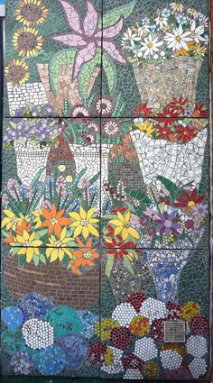 Flower Mosaic: Blue Florist    This colourful mosaic is on the side of Blue Florist at Kingston Railway Station. It's 90% recycled tiles and I love the fact that old ceramics have been used. The wrapping around the bunches of flowers is all tiny pieces of old china. It's part of a large mural of rail travel.