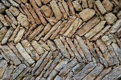 The beautiful rock walls that are a traditional form of architecture in Valpolicella.  They are made without mortar.