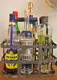 A bottle caddy brought home from a flea market in Provence holds the taller bottles, and becomes my kind of room decor.