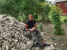 personal stories, photo exhibit, Detroit-Unbroken Down. Kat (Kathina) took over an empty city corner lot next to her house and transformed it into a neighborhood park complete with lighting, bench...