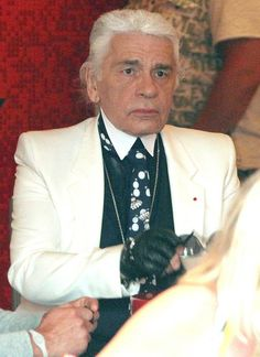 Karl Lagerfeld without sunglasses totally looks like an old Fred Armisen