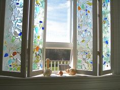 Seaglass mosaic window. For more ideas with seaglass, browse Completely Coastal:  http://www.completely-coastal.com/search/label/Seaglass%20Crafts