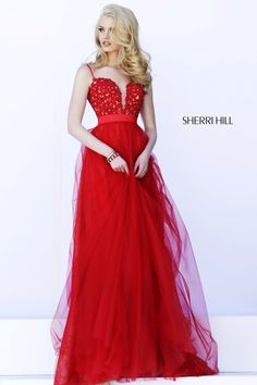 """SHERRI HILL Prom Dresses 2015 # 32229 Spaghetti straps hold up the fitted lace bodice with deep """"V"""" plunge in back and front. A full length lace skirt shows through layers of tulle while a satin bow cinches the waist."""