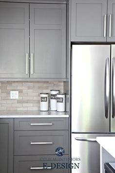 Gray painted kitchen cabinets, Benjamin Moore Amherst Gray. Quartz white countertops, limestone backsplash. Kylie M E-design and online color consulting