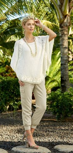 This Crochet Poncho is beyond versatile. It takes you from the beach to dinner and everywhere in between.