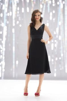 Description: Black crinkle chiffon v-neck knee length dress with pleated midriff and  a-line skirt.