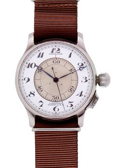 LONGINES - WITTNAUER «Weems», circa 1930.  Very fine and rare stanless steel pilot wristwatch, massive hinged case, white enamel annular dial, Breguet numerals, revolving central disk graduated for 60 seconds, center seconds, blued steel hands, fixed bars. Diam. 47 mm.  Boule Auctions  -  Vintage and rare watches Public auction in Monte-Carlo  -   July 28th, 2012  Web catalog on : www.boule-auctions.com