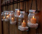 Repurpose Mason Jars....they look beautiful!  DIY Hanging Mason Jar Luminary Lantern Lids - Set of 12. $45.00, via Etsy.