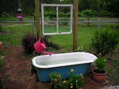 Fountain from old vintage tub .. still landscaping around it and waiting for the jasmine to grow around window.
