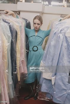 English fashion model Twiggy pictured wearing a turquoise blue knee length one piece play suit as she stands between two rails of clothes in the store room of her new boutique in London on January London Fashion, Retro Fashion, Vintage Fashion, Sixties Fashion, Twiggy Hair, English Fashion, Fashion Models, Fashion Trends, Fast Fashion