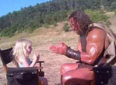 'When a 2yr old asks HERCULES to play patty cake on set.. well.. he plays patty cake. #HERCULESMovie ' Dwayne 'The Rock' Johnson plays patty cake in a set photo from 'Hercules.'
