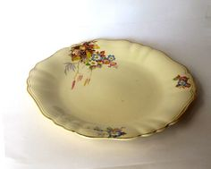 Floral porcelain serving plate. Yellow ceramic dish. Gold trim platter. J and G Meakin. England. Mid century.