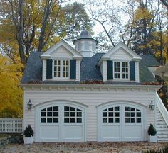Pretty as a picture garage w/guest suite upstairs – charming. Love the garage do… Pretty as a picture garage w/guest suite upstairs – charming. Love the garage doors. Pretty as a picture garage w/guest suite upstairs – charming. Love the garage do… Carriage House Garage Doors, Garage Guest House, Dream Garage, Garage Design, House Design, Mansion Homes, Loft Plan, Garage Door Styles, Garage Addition