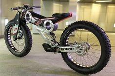 """The Moto Parilla Carbon comes to life as a heavily motorcycle-inspired electric off-road bike with claims of being the """"SUV e-bike."""" After a fling with British carmaker Caterham, its designers are pressing ahead alone. Scooters, Electric Bike Kits, Off Road Bikes, Fat Bike, Bike Design, Motorcycle Design, Cycling Bikes, Custom Bikes, Custom Moped"""