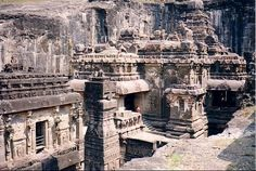 """Ellora* is an archaeological site in Maharashtra, India built by the Rashtrakuta dynasty. Ellora represents the epitome of Indian rock-cut architecture. The 34 """"caves"""" are actually structures excavated out of the vertical face of the Charanandri hills. Buddhist, Hindu and Jain rock-cut temples and viharas and mathas were built between the 5th century and 10th century. 12 Buddhist (caves 1–12), 17 Hindu (caves 13–29) and 5 Jain (caves 30–34) caves, built in proximity."""