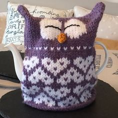 http://www.ravelry.com/patterns/library/owl-heart-tea-cosy