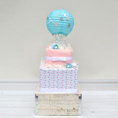 Items similar to Hot Air Balloon Shower Diaper Decoration, Baby Girl Hot Air Balloon Diaper Cake, Up and Away Baby Shower Centerpiece, Unique Diaper Cake on Etsy Baby Shower Registry, Baby Shower Diapers, Baby Boy Shower, Baby Shower Gifts, Unique Baby Girl Gifts, Baby Gifts, Diaper Cake Boy, Cake Baby, Unique Diaper Cakes