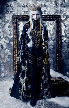 this doll has the full set of costumes from crown to hair to robes..