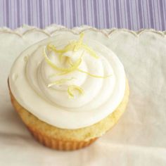 This Lemon Dreams Cupcake is filled with Sweet-tart lemon curd. Yum! See more cupcake recipes: http://www.bhg.com/recipes/desserts/cupcakes/our-favorite-filled-cupcakes/