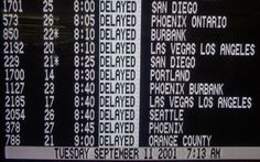 Delayed Southwest Airlines flights are seen on a television monitor after the attacks, at the Oakland International Airport in California. All flights in the country regulated by the FAA were cancelled, stranding travelers nationwide.
