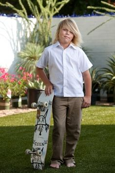 """http://theguayaberashirtstore.com We've got the young men covered. Try our our super stylish kids to young adult sized linen or """"pinpoint cotton oxford cloth"""" Guayaberas. The perfect combo for that beach wedding or that child that looks the tropical lifestyle. 100% linen, 100% handmade with love."""