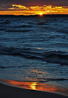 Lake Michigan Sunset from the shore in Leland by Pure Michigan, via Flickr